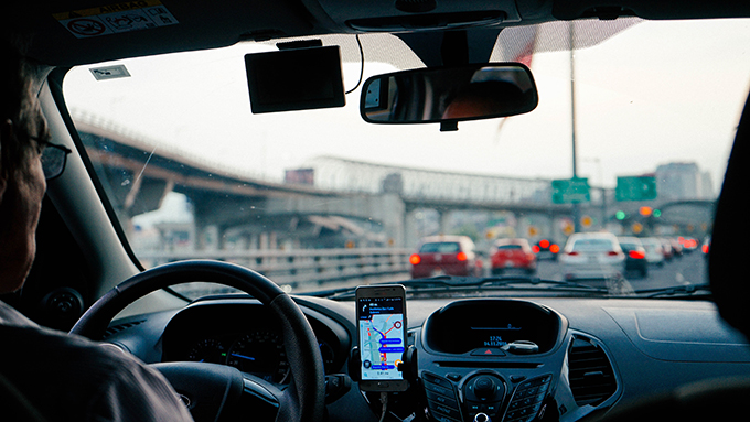 Smartphone use is driving traffic accident numbers and car insurance rates up, study claims