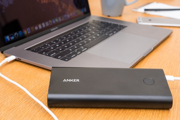 The anker powercore usb-c battery pack plugged into a laptop.