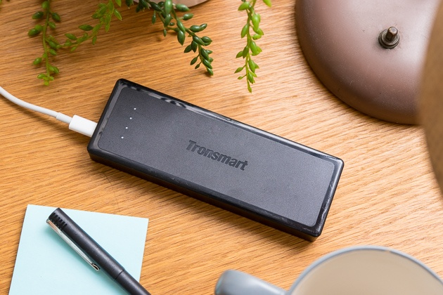 The tronsmart presto usb-c battery pack sitting on a desk.