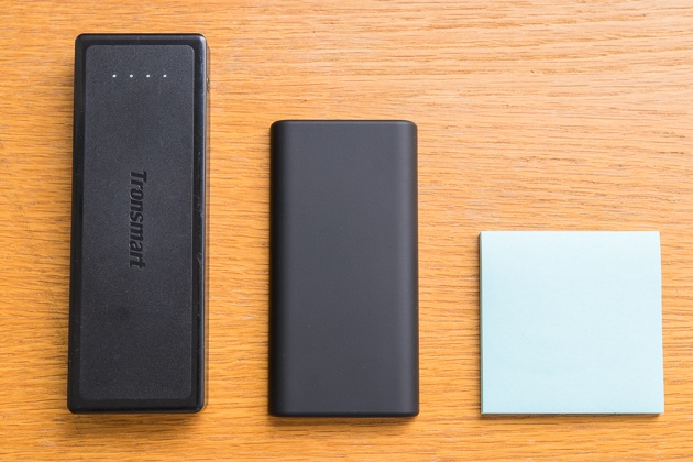 The tronsmart presto and anker slim usb-c battery packs on a table top next to a post it note for scale.